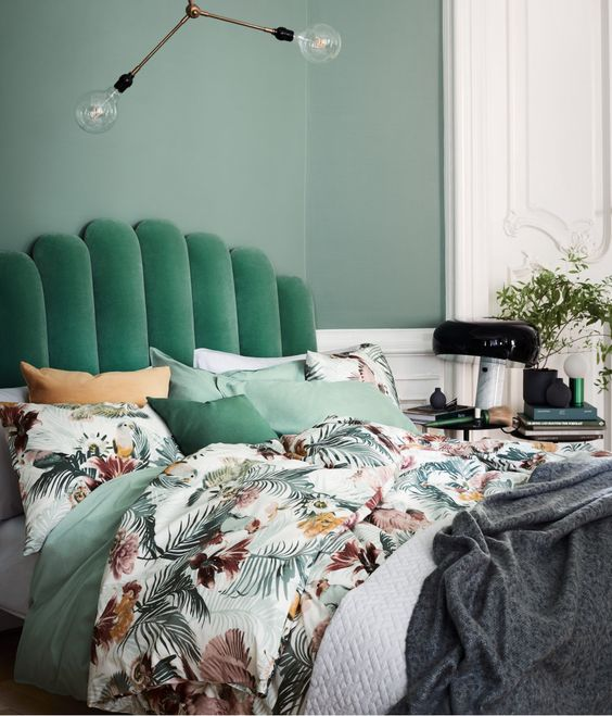 a green emerald upholstered headboard for a modern bedroom