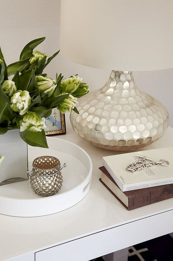 a lamp base is covered with mother of pearl and will be a great fit for an exquisite or glam space