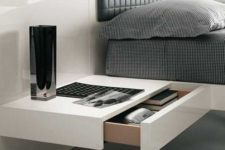 23 a minimalist white bedside table with a drawer is all you need