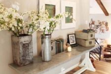 23 a modern version of trestle table with a concrete top to use it as a durable entryway console