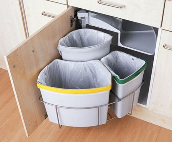 a rotating trash can allows to accomodate more trash cans and comfortable using