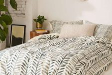 23 boho and mid-century modern bedding with a muted green botanical print
