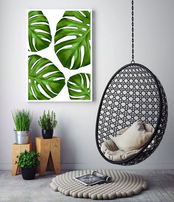 a colorful monstera leaf wall art echoes with the greenery below