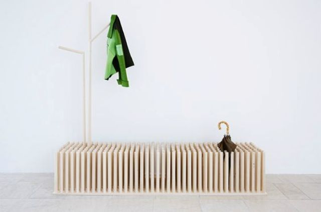 a creative entryway bench with storage in between beams is a cool modern idea