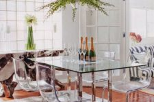 24 a dining table with metal legs and acrylic chairs on the same legs look modern, chic and ethereal