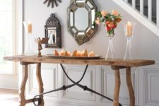 24 a rustic trestle console table with blackened metal decor echoes with vintage metal framed mirrors