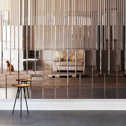 mirror panel wall looks very eye-catching and it's a unique idea for a statement wall
