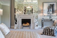 25 a large geo mirror accent for the fireplace looks shiny and glam