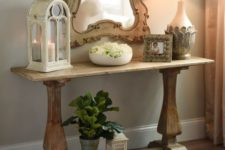 25 a small trestle table used as a console for a vintage-inspired entryway