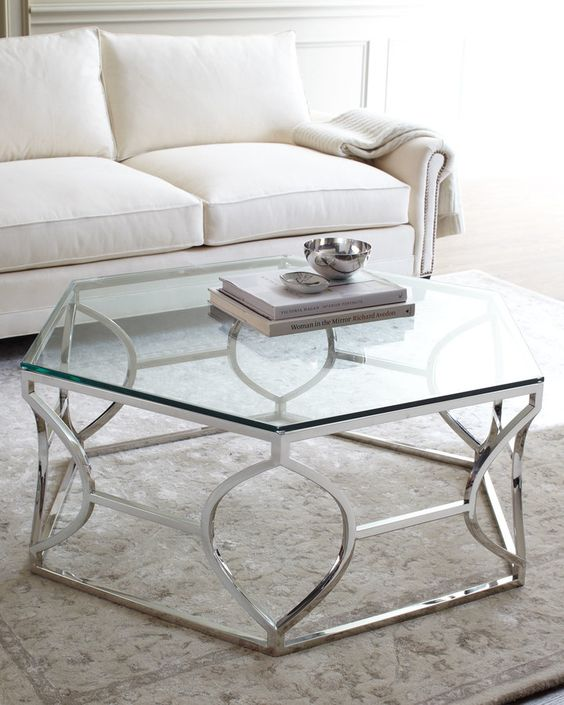 an art deco inspired coffee table with a polished geo base and a hexagon tabletop to add chic to your space