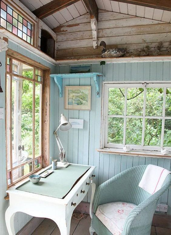 aqua and turquoise colored home office in a she shed looks cozy and cute