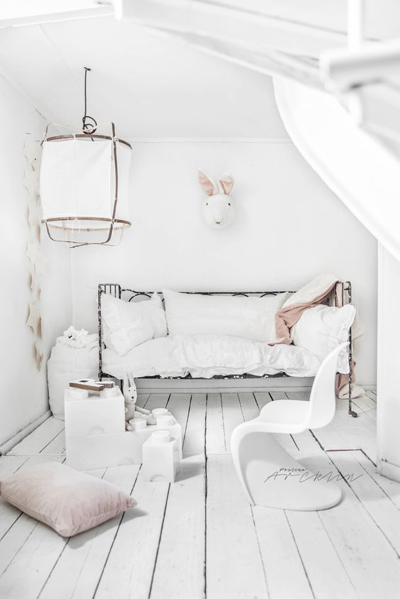 Nordic-inspired kids' room with a toy rabbit head and stars on the wall