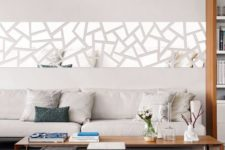26 a modern geo mirror wall decal over the sofa for a modern feel