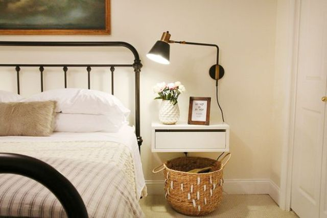 a simple white drawer nightstand looks very airy and doesn't make the room look bulky