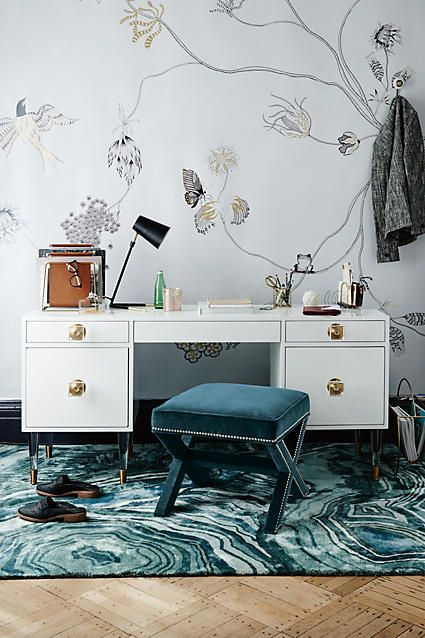 a teal stool and printed rug of velvet for a girlish home office