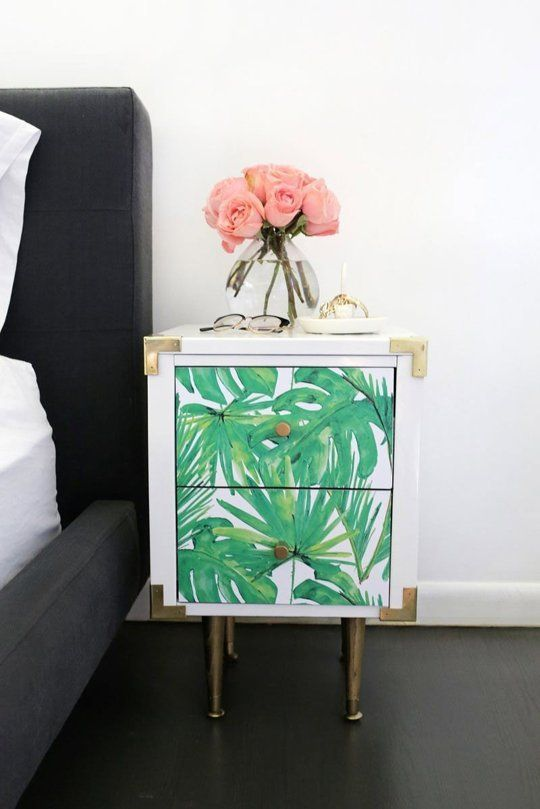 a tropical leaf nightstand with chic metallic touches