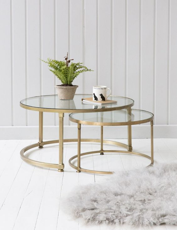 brass round coffee table duo with glass tabletops