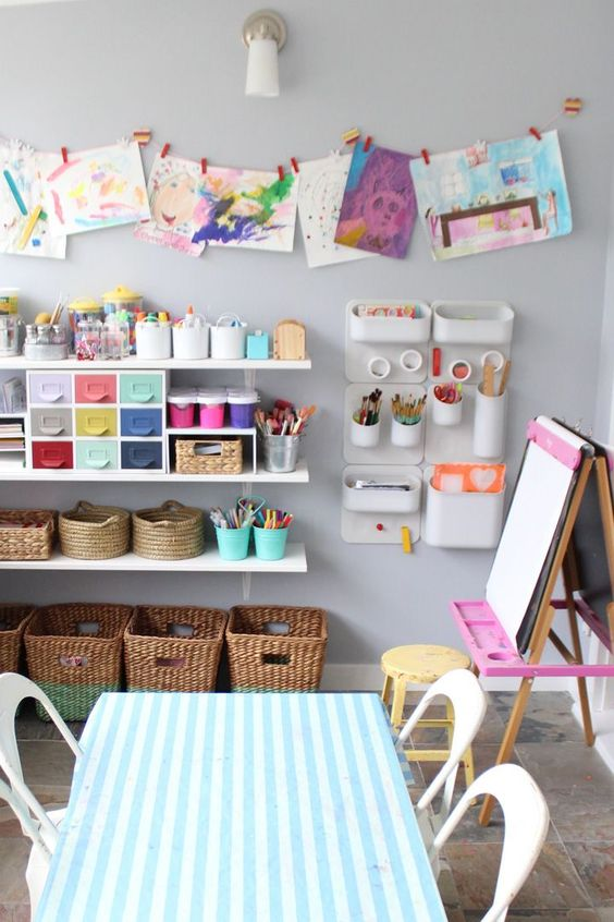 display children's art pieces on the wall to make them proud