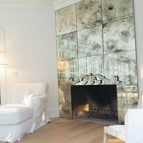highlight the fireplace with a faded mirror cover to make it stand out in a refined way