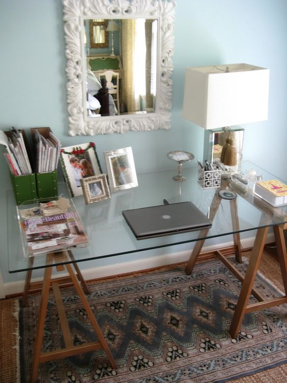 a combo of stained wooden trestle legs and a glass tabletop can be a nice refreshing idea for a rustic home office