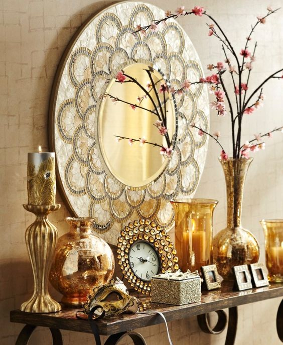 a round mirror inlaid with mother of pearl for a refined home display