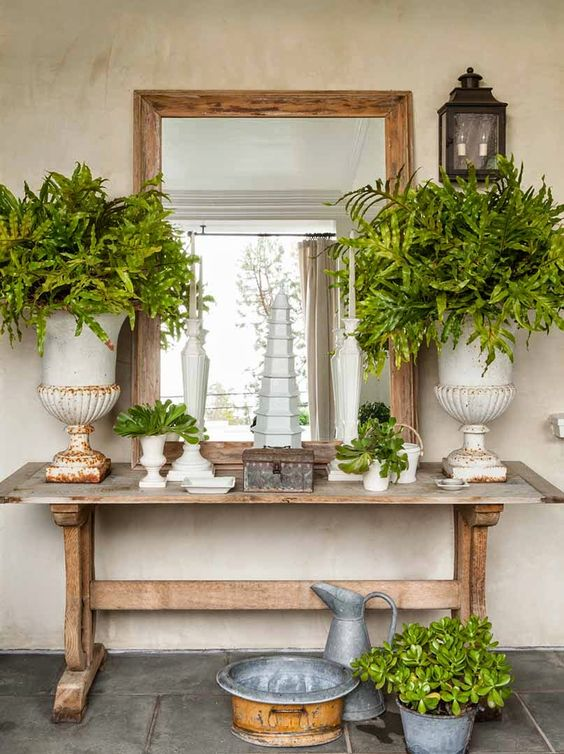 a trestle table used as a console in a shabby chic entryway - such a cozy and comfy in using piece