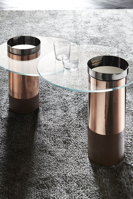 chic round modern coffee tables with copper bases with glass tabletops will spruce up your space