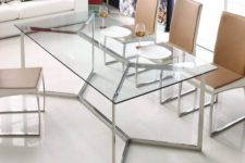 28 a chic and edgy dining table with a metal framing and a glass tabletop looks amazing