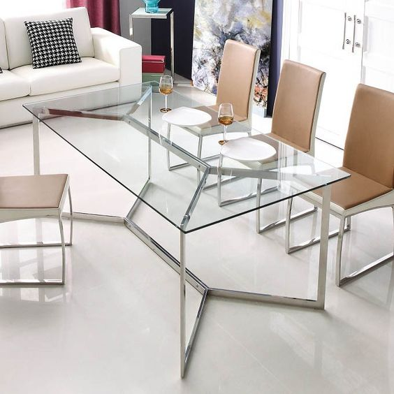 a chic and edgy dining table with a metal framing and a glass tabletop looks amazing