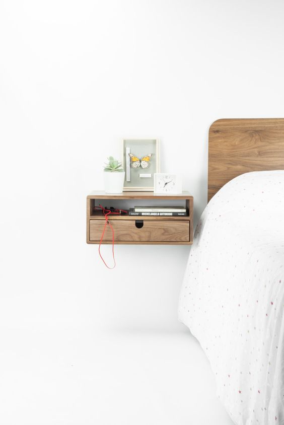 a tiny stylish wooden nightstand with an open storage space and a drawer
