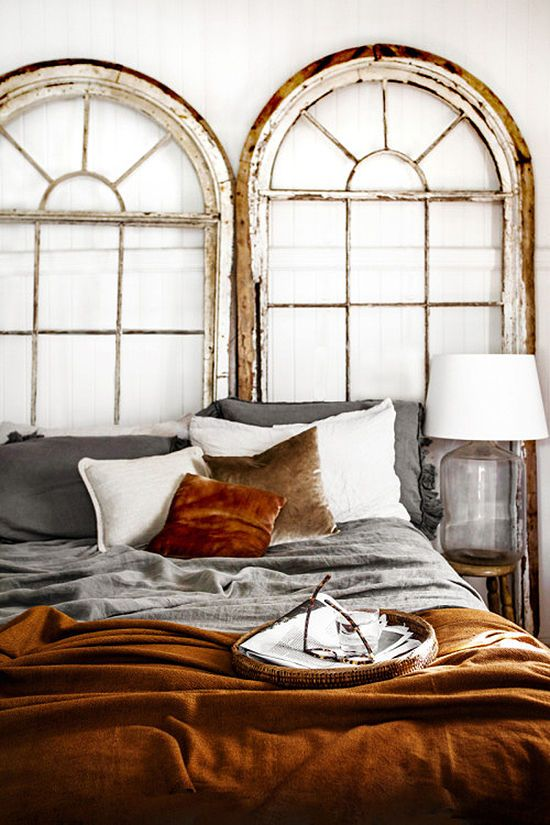 an amber velvet bedspread and a matching pillow add style to this shabby chic bedroom