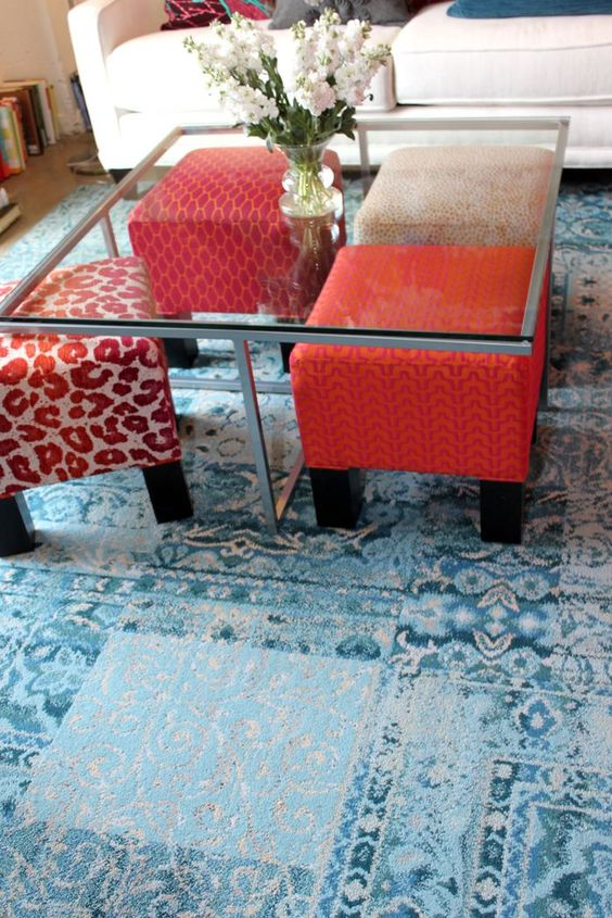 metal frame glass coffee table with a sculptural metal base and an opportunity to place ottomans there