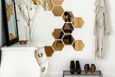 28 such hexagonal mirror decals will make the space more interesting