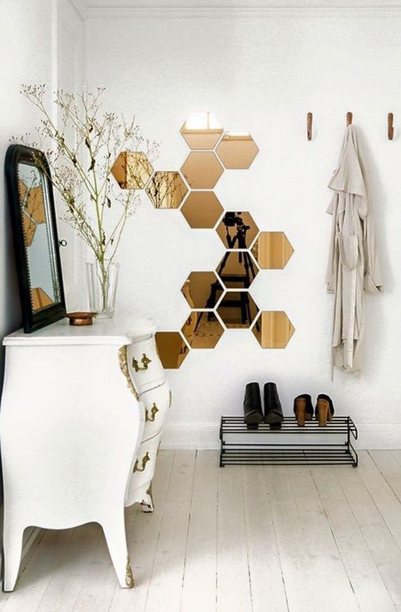 such hexagonal mirror decals will make the space more interesting