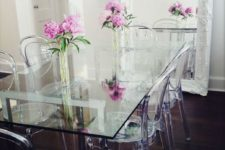 29 a vintage dining room is made more eye-catching with an ultra-modern glass top dining table and acrylic chairs