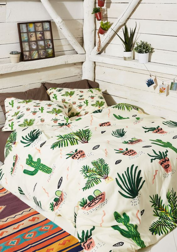 whimsy and funny cactus print bedding in green and pink hues