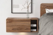 30 a wooden floating nightstand with a sliding door for comfy storage