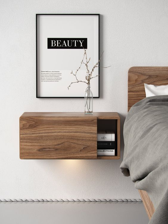 a wooden floating nightstand with a sliding door for comfy storage