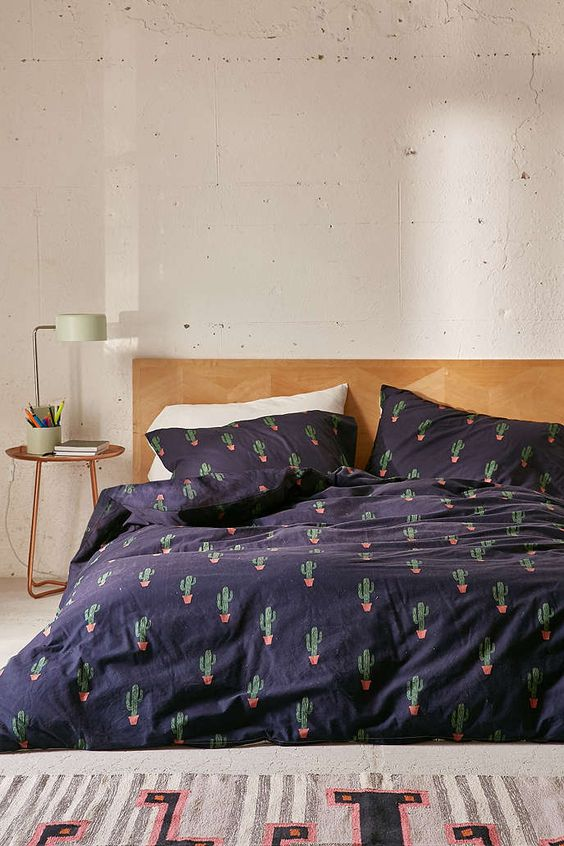 navy bedding set with a cactus print for a desert-inspired space