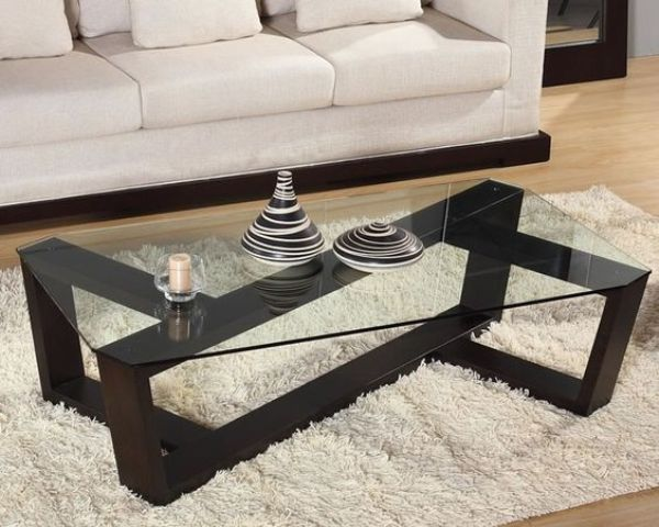 Ultra Modern Coffee Table With A Sculptural Dark Stained Wooden Base And Glass Tabletop