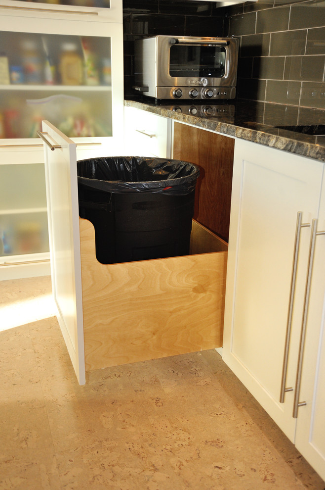 a family size trash can in a pull out cabinet (Kevin Martin)