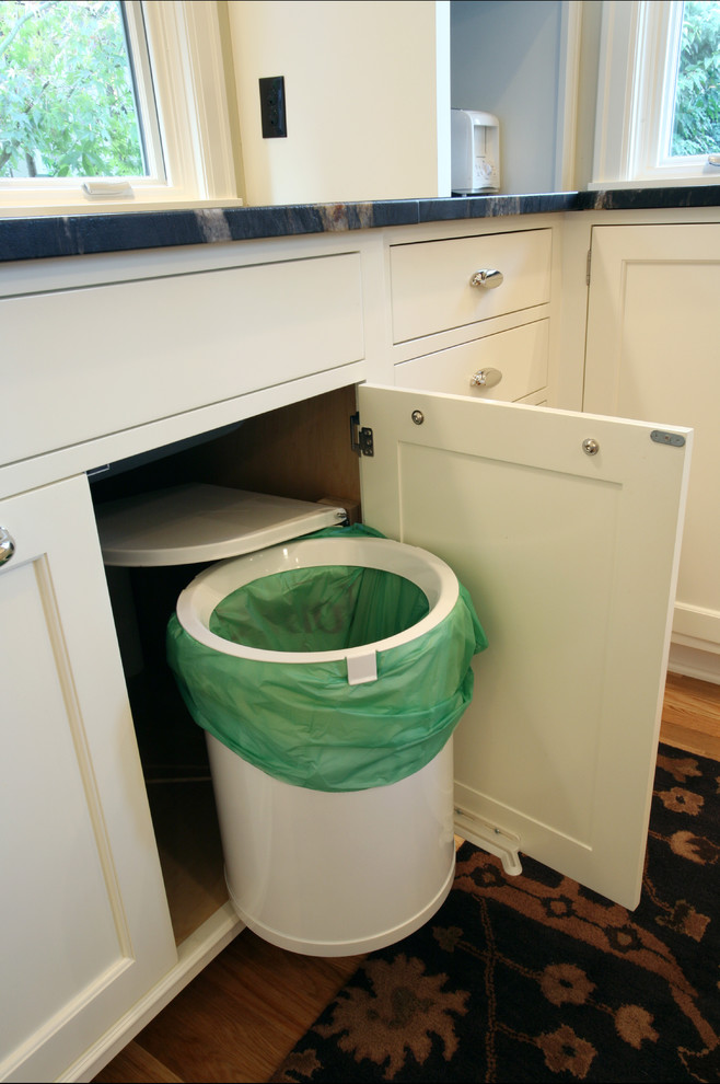 a super smart trash can pull-out with a lid that opens automatically (Rockwood Cabinetry)