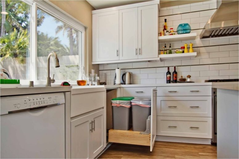 a smart use of a corner cabinet for trash can storage (Jackson Design & Remodeling)