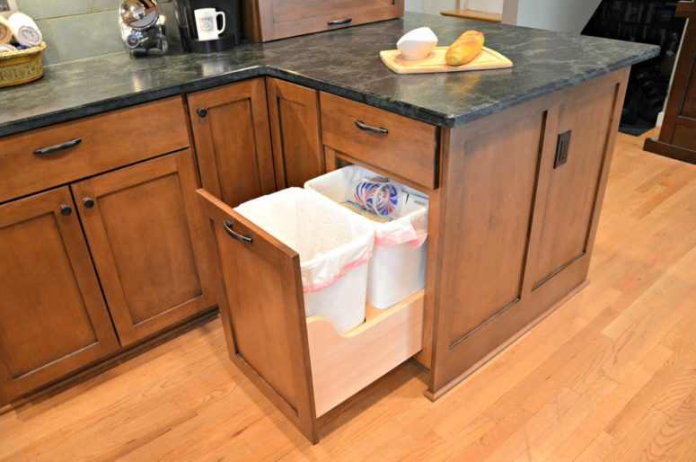 a craftsman kitchen can feature smart hidden trash can storage too