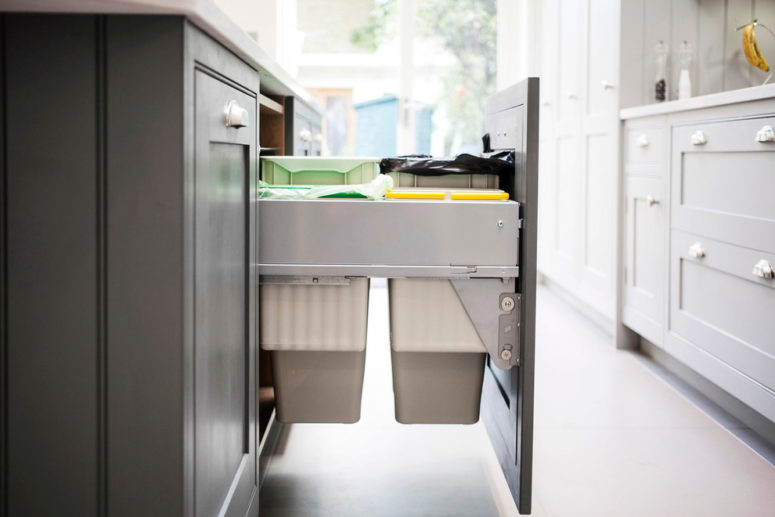 pull-out trash cans could easily be used to sort trash in way you need (burlanes interiors)