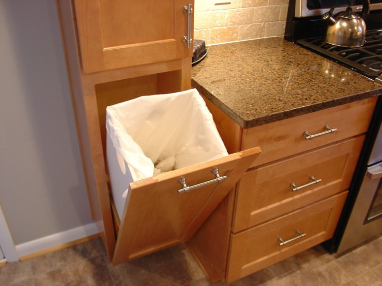 a cool custom tilt out trash can (Lazzell Design Works Remodeling)