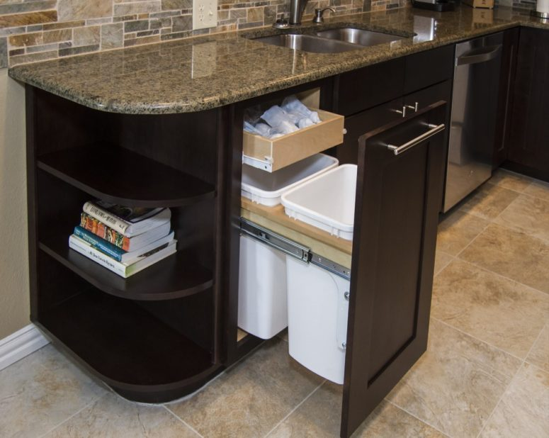 store garbage bags close to trash cans by designing smart cabinets