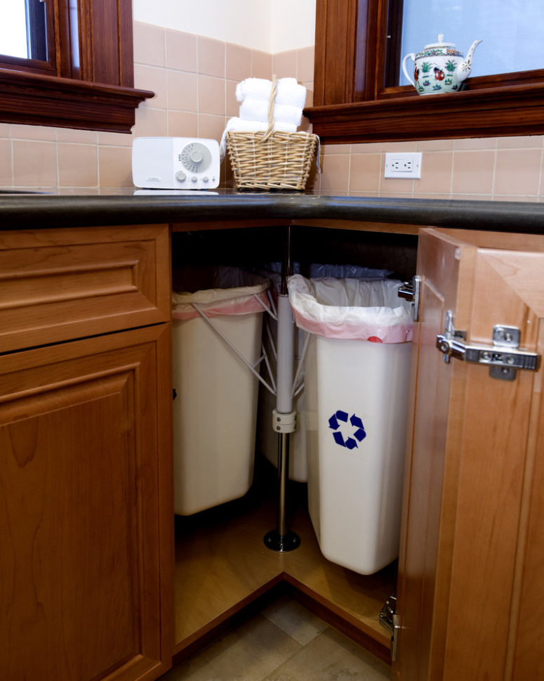 corner cabinets are perfect for trash cans
