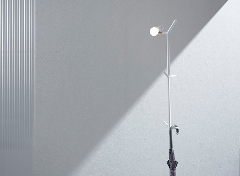 Myna is a minimalist piece for the hallway, and it comprises a coat rack and a floor lamp in one without having too many details