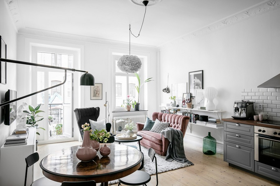 This Scandinavian apartment features beautiful historical elements and some pastel and muted touches here and there